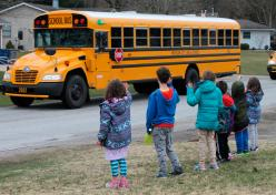 Photo of students waving to school bus