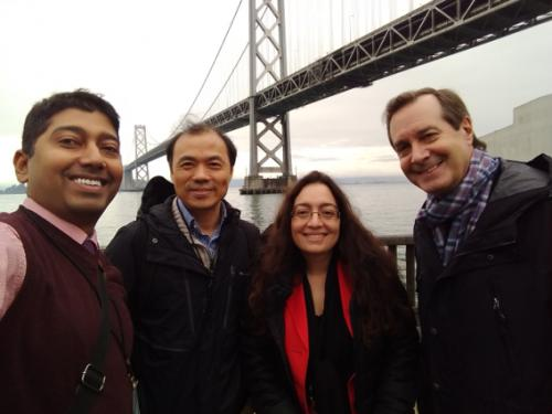Professors Chakraborty, Zhang, and El-Gohary with Coach Glenn near Bay Bridge in San Francisco