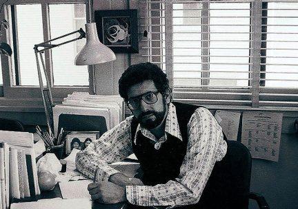 Len Heumann at his desk