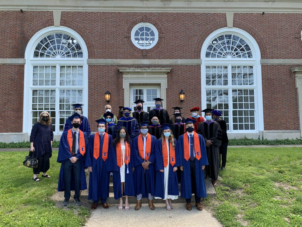 BAUSP graduates and faculty posing in front of Stock Pavilion