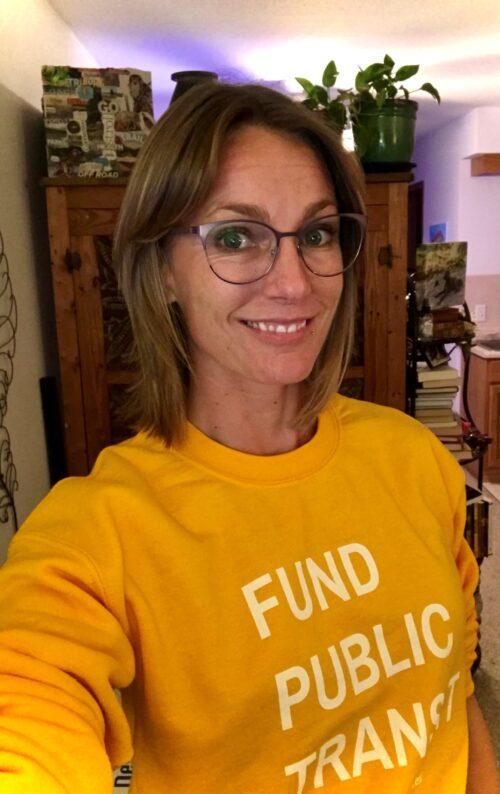 Photo of Amanda Merck in a bright yellow sweatshirt