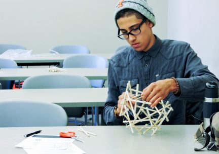 Student working on a stick model