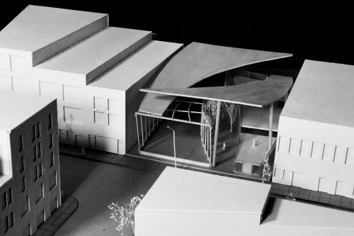 Aerial view of model with split curved roof