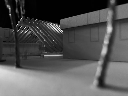 Black and white image: model of slanted roof