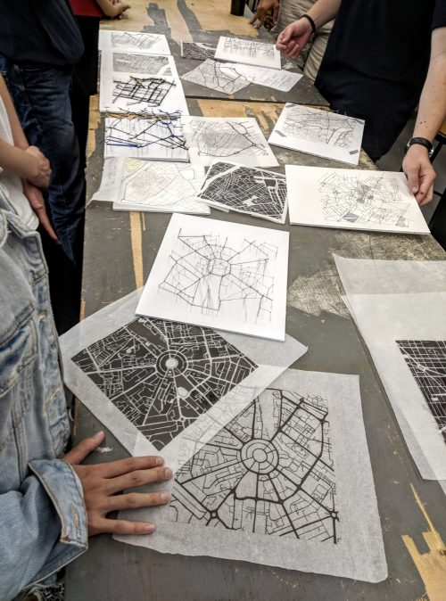 View of table covered in urban analysis drawings