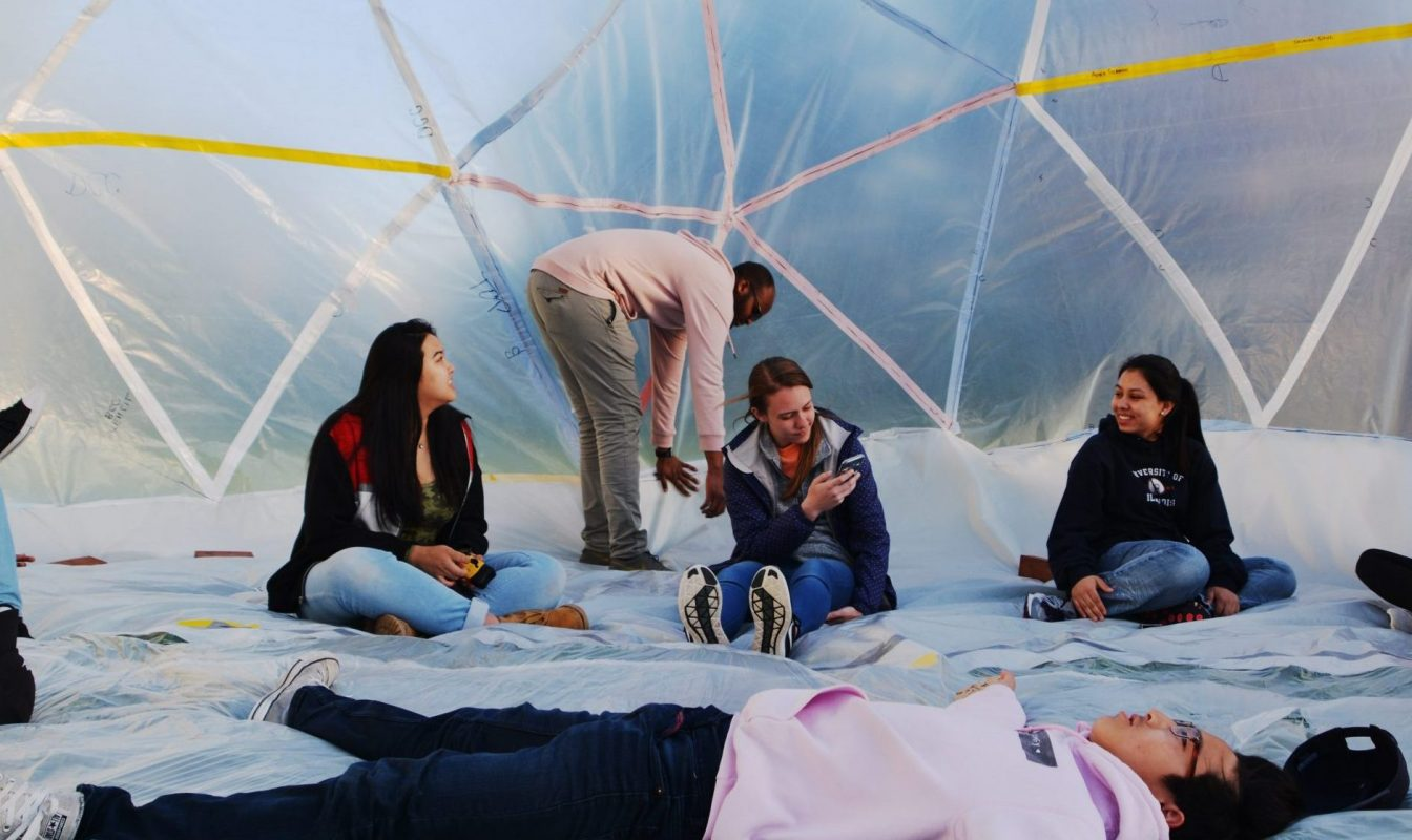 students inside an inflatable dome