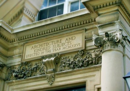 Photo of engraving above architecture building