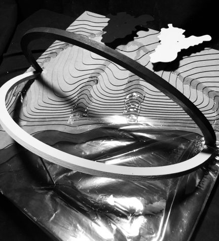 black and white image of topography model with two large arcs