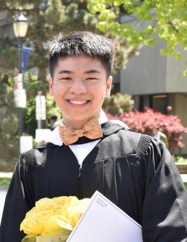 Headshot of Andrew Wei in graduation clothing