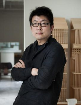 Headshot of Gong Dong in his office