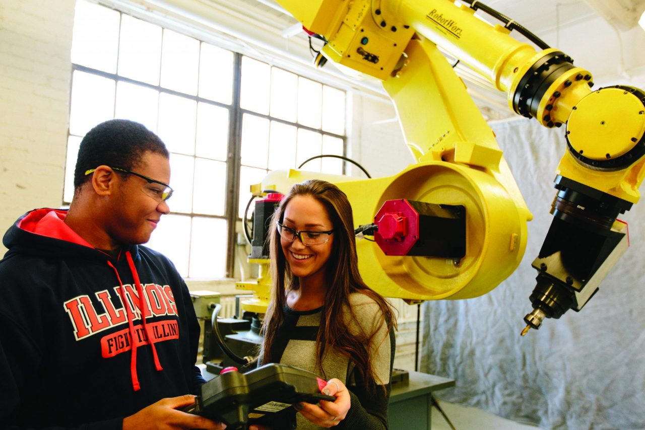 Two students using the robotic arm