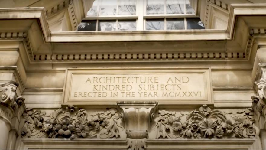 Closeup of an engraving on the school of architecture building