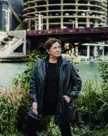 Carol Ross Barney standing next to the Chicago River