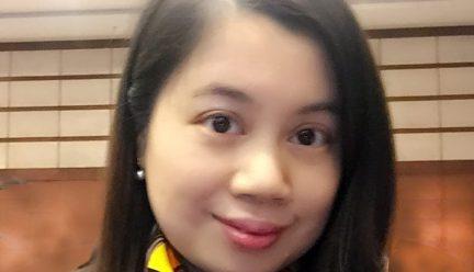 headshot of hua yue on white background