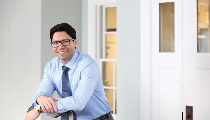 headshot of alex patsavas standing in an office