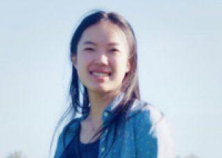 headshot of hua yue outside
