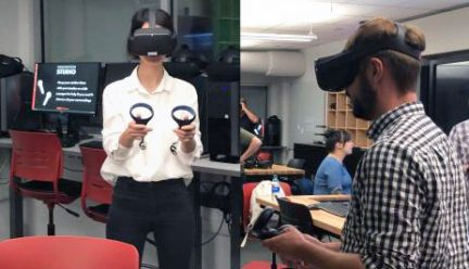 two students wearing virtual reality goggles