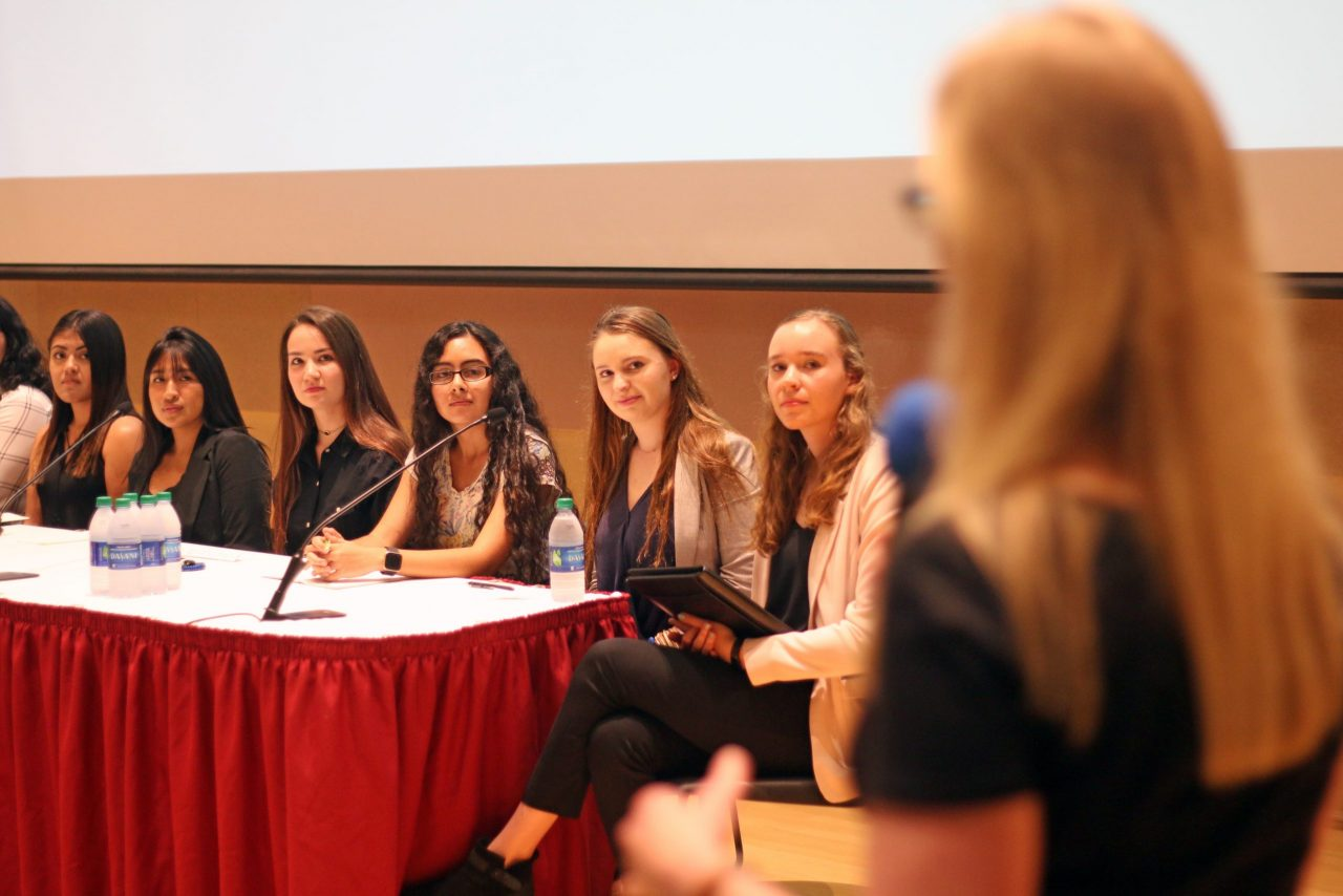 Attendees of the women's symposium at a table
