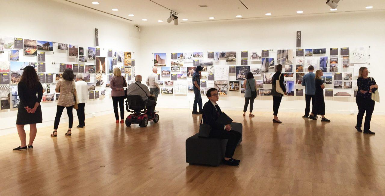 Exhibit visitors at the Krannert Art Museum viewing the women's symposium exhibit