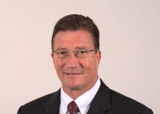 Headshot of Bill tucker against light background