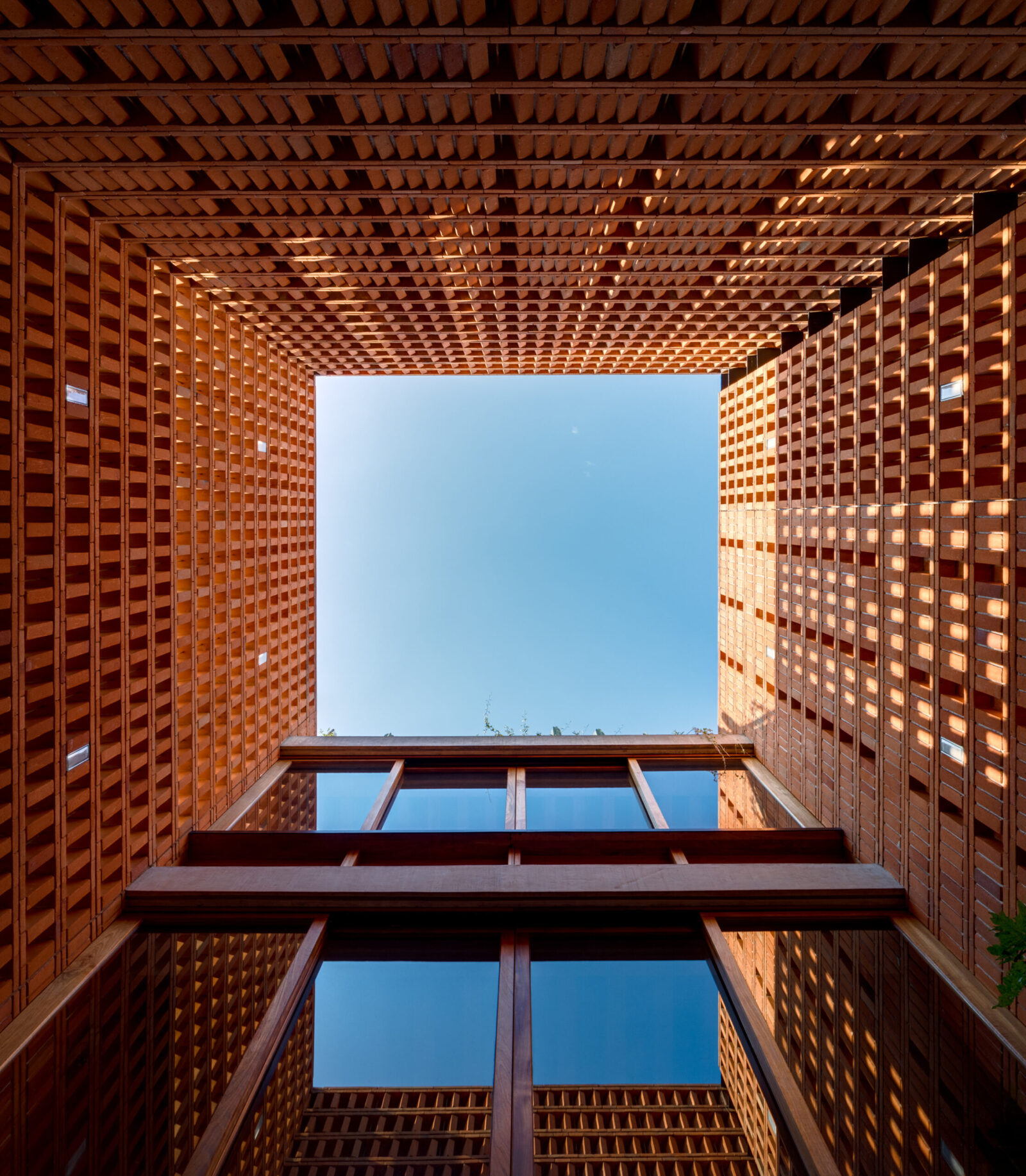 perspective photo looking up from a building courtyard