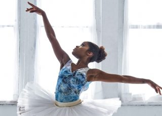 Ballerina with arms out