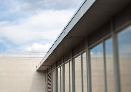 Artful exterior photograph of the eaves on the Link Gallery