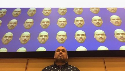 Jorge Lucero with artwork