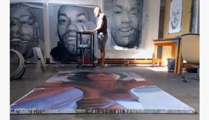 Patrick Earl Hammie in the studio with paintings