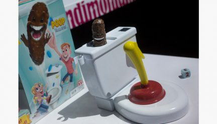 Toy toilet and plunger with poop book