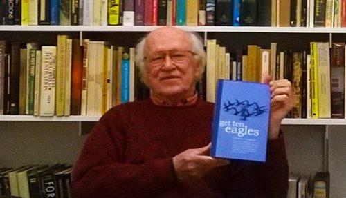Ed Zagorski holding book