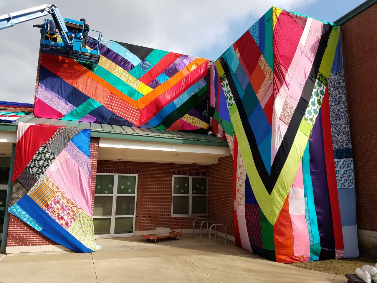 View of colorful fabric installation around the entrance of Stratton Elementary School