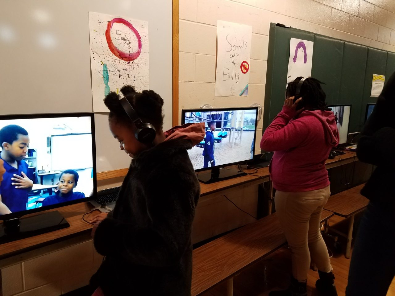 Young people interacting with art education videos