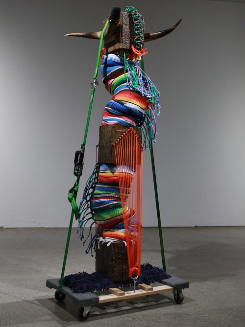 Photo of a colorful vertical multimedia sculpture