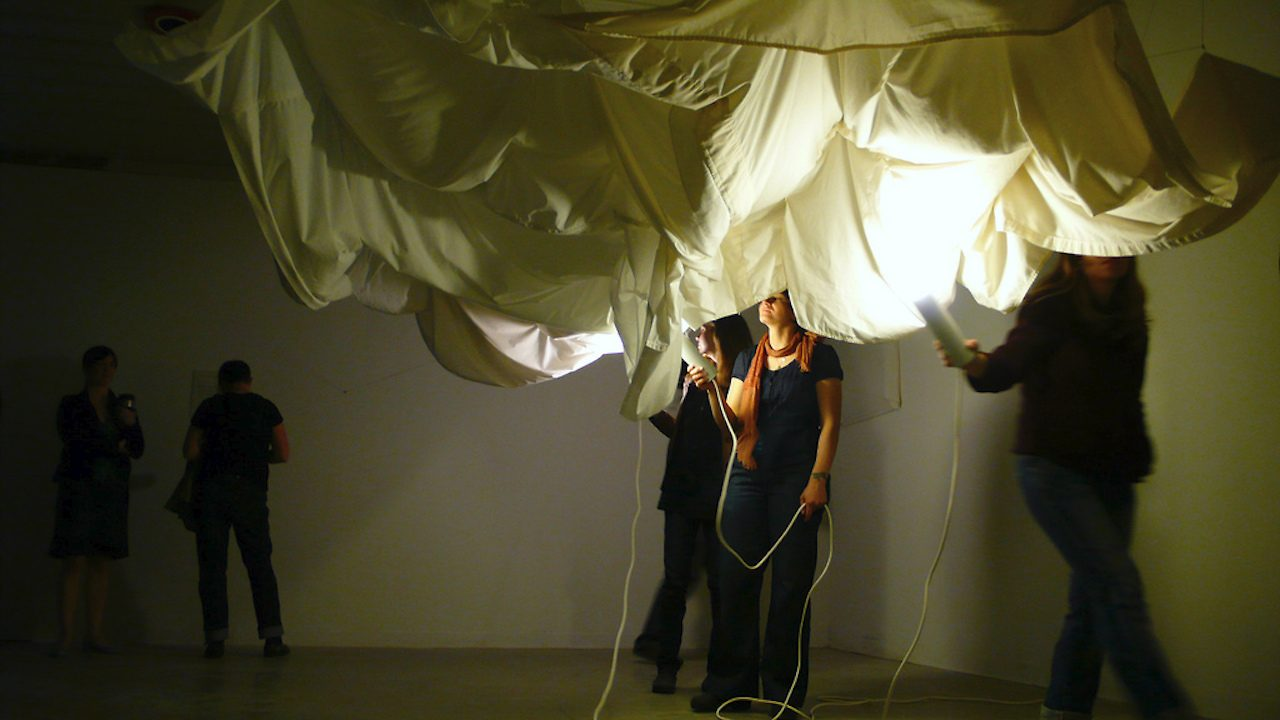 Photo of art installation with fabric draped from the ceiling