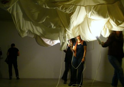 Photo of students exploring an art installation