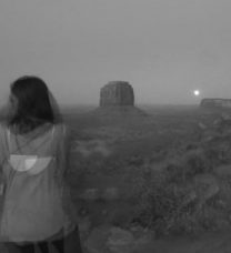 Artfully exposed soft B&W photo of the student in a canyon landscape