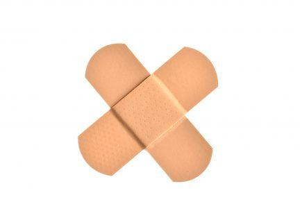 Photo of two bandaids forming an