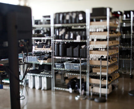 camera equipment on metal shelves