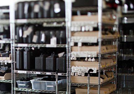 Photo of reservable equipment arrayed on metal shelves