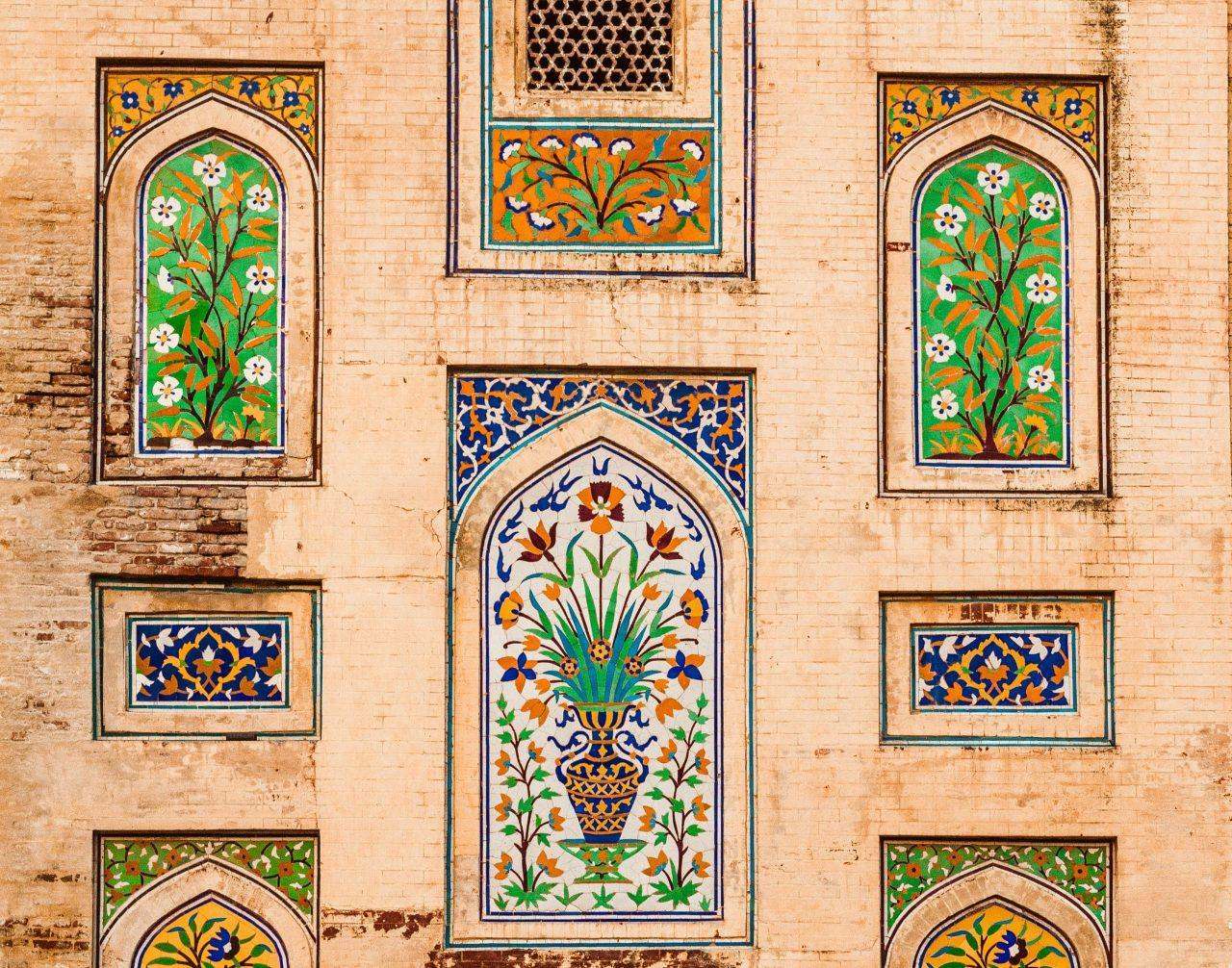 Exterior wall inset with colorful mosaics