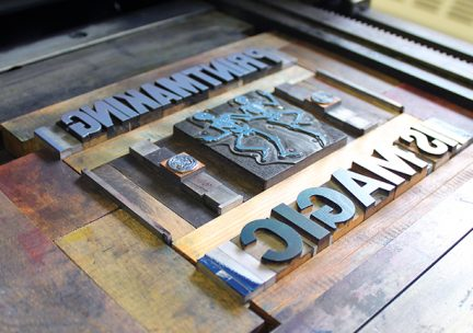 Photo of relief blocks on a printing press