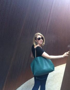 Portrait of the smiling student in an immersive artwork by Richard Serra
