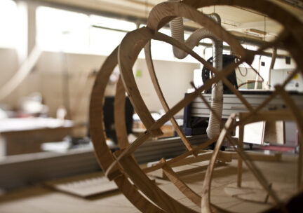 wooden framed orb on cnc router in woodshop