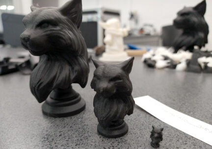 3 3D printed black cat busts made of ABS plastic