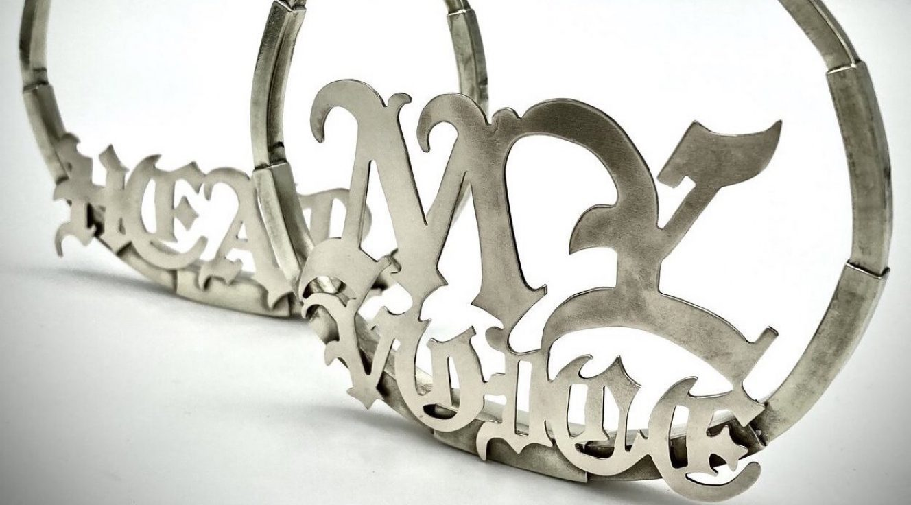 Photo of brass hoop earrings that spell out the words