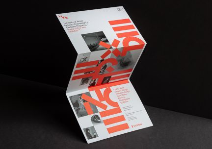 Photo of designed brochure with red letters on a light ground