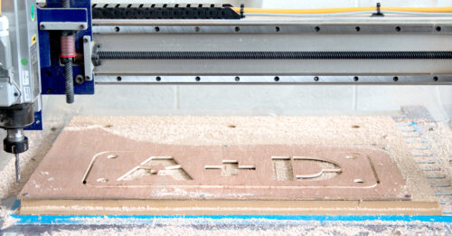 cnc cut wood with the letters