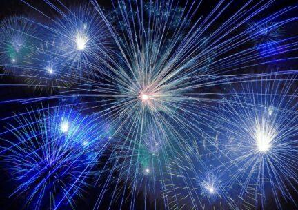 Blue fireworks in a dark sky