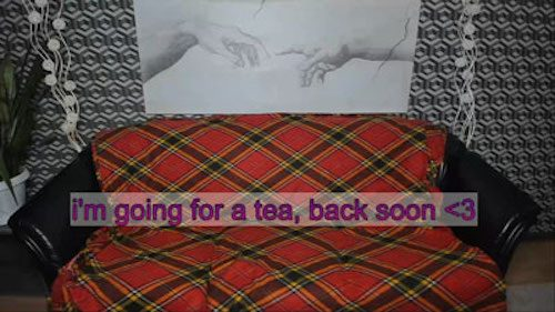 Photo of a couch covered with a red plaid blanket and the words